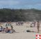 Beach Patrons Enjoying Sun Exposure